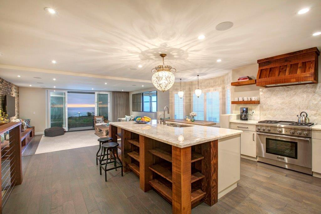 contemporary ocean front kitchen with antique french chandelier