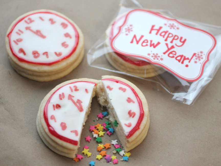 these amazing cookies were made by http://www.repeatcrafterme.com/2012/12/new-years-confetti-clock-cookies.html